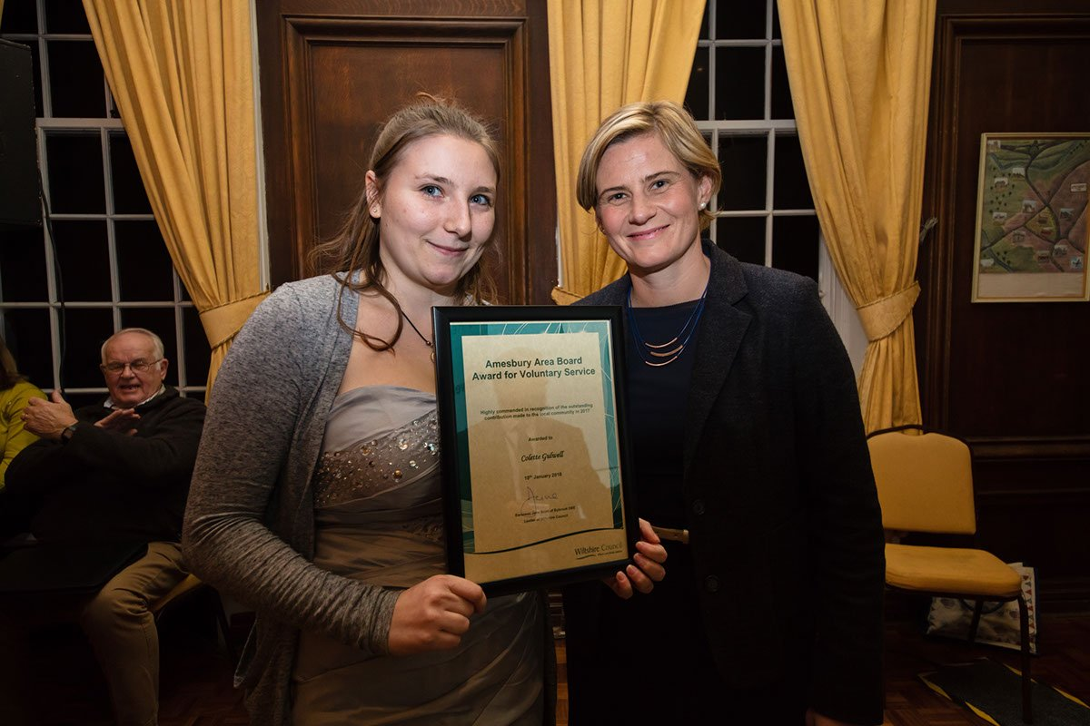 Collette receives her Highly Commended certificate from Cornelia Oosthuizen